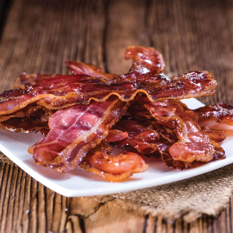 crispy bacon on a white plate
