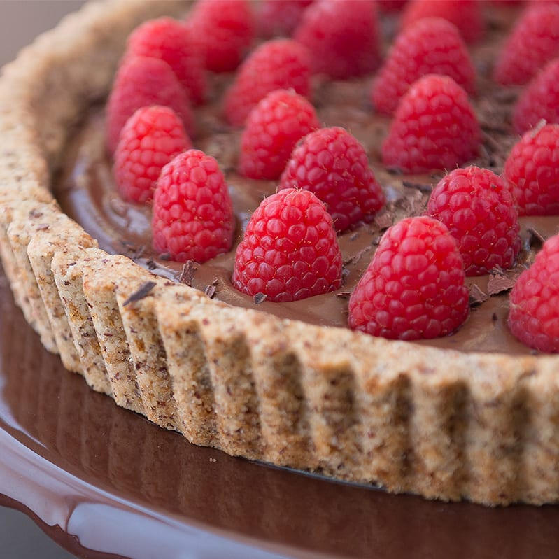 photo of a vegan chocolate raspberry tart