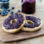 photo of a toasted bagel with vegan blueberry jam