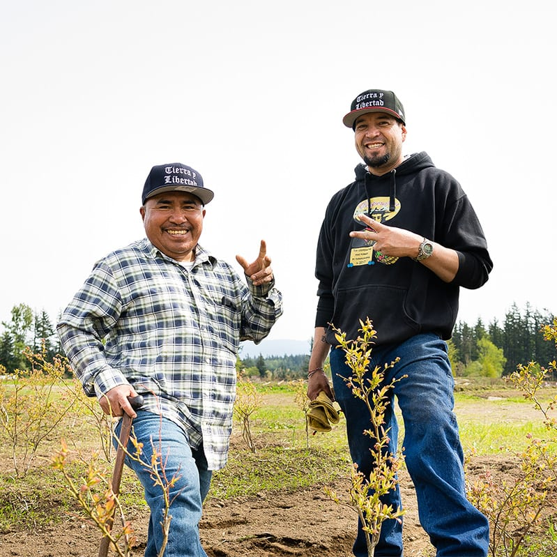 the cofounders of cooperativa tierra y libertad on their farm in everson washington